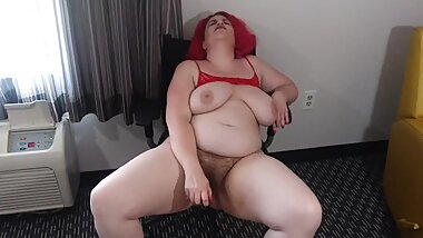 BBW in red sheer pants outfit & stripper heels, rams her hairy squirting pussy with a glass dildo.